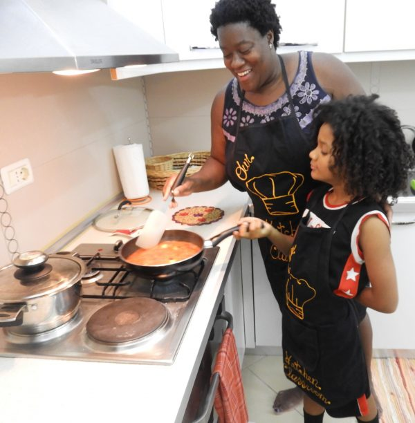 Head Chef Karen M. Ricks and Our Little Sous in the kitchen together in Albania