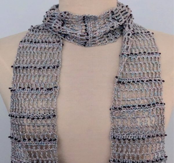 crochet summer scarf with silver yarn and dark purple beads