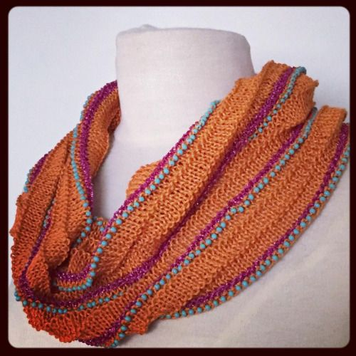 cowl with orange and magenta yarn and turquoise beads