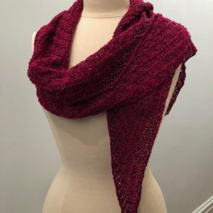 a shawlette with raspberry yarn with black diamond beads
